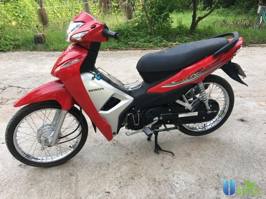 Xe Honda Wave Alpha màu đỏ tươi sáng, bắt mắt.