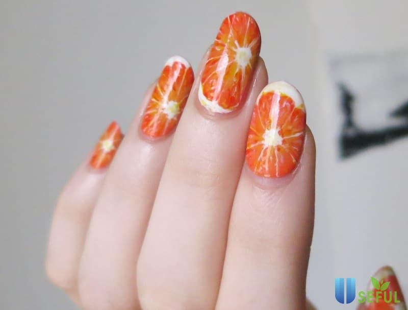 Mẫu nail trái cây hình trái cam tạo cảm giác sảng khoái
